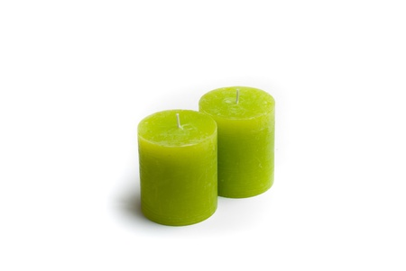 Two green candles without flame on white