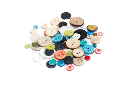 Many colours of isolated  buttons from clothing Stock Photo