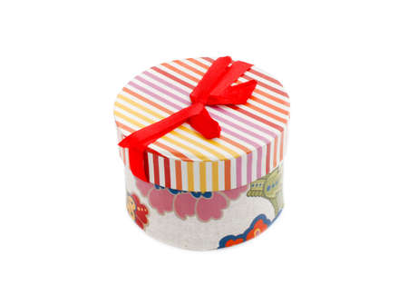 Colored gift box with red ribbon