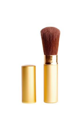 isolated brush for blush in gold case