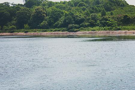 insolación: Imagen que representa la costa del mar día soleado de verano.