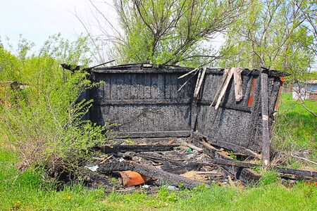 The photo shows the burnt down wooden structure.