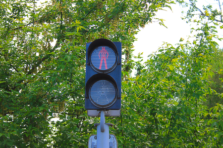depicts: Photo on which depicts the traffic light at the intersection. Stock Photo