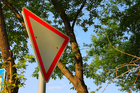depicts: Photo on which depicts a road sign.