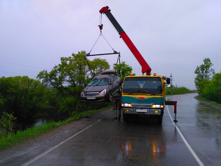 evacuating: A photograph depicting a tow truck evacuating a vehicle.