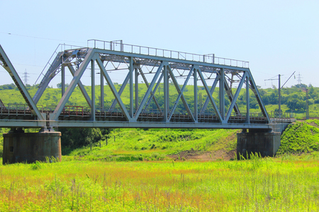 A photo depicting a large railway bridge.