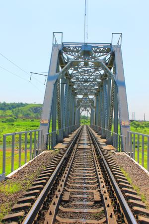A photo depicting a large railway bridge.