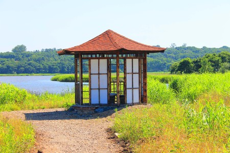 A photo depicts a gazebo on the water.