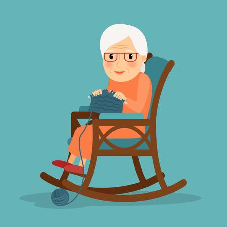 Maglieria. Old Woman maglia. Nonna maglieria nella sua sedia a dondolo.