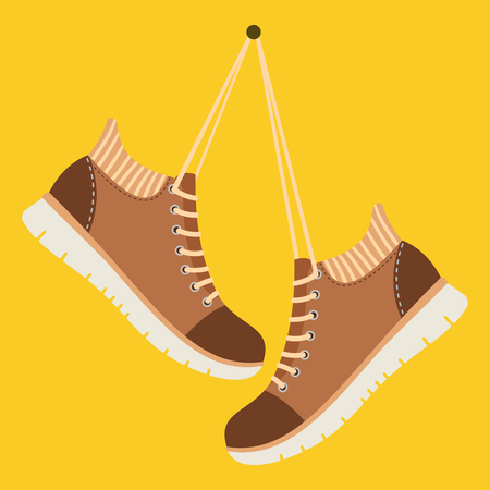 Brown shoes hang on laces Illustration