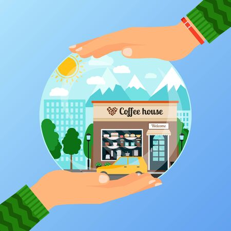 Hands holding a glass ball with a coffee house building