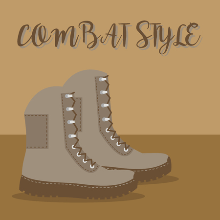 Pair of brown boots with combat style text on a brown background