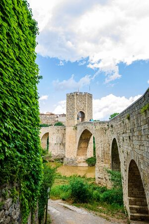 Medieval bridge of Besalu. View from north fortificated town. Garrotxa, Girona, Catalonia, Spain