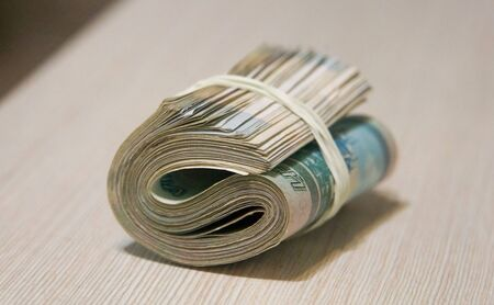 twisted wad of money, banknote packing Stok Fotoğraf