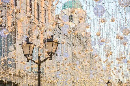 street lamp among christmas lights, christmas street, decorated street