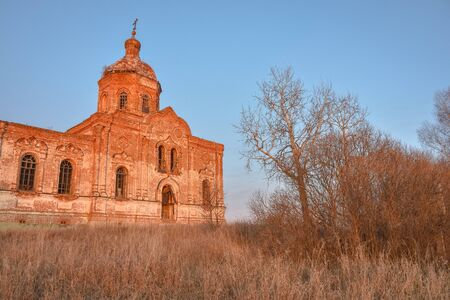 An ancient abandoned and ruined Church, crumbling red brick temple, An abandoned red brick temple illuminated by sunset sun, an abandoned church at sunset, an abandoned Annunciation Church