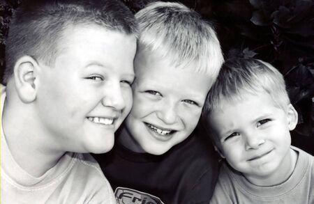 Portrait of three boys in black & white.