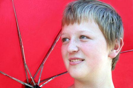 Horizontal portrait of a boy holding a red umbrella. Stock Photo - 354536