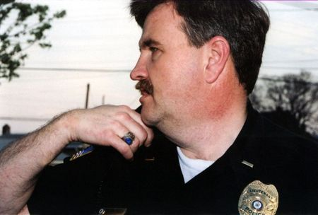 Portrait of police officer talking on radio.