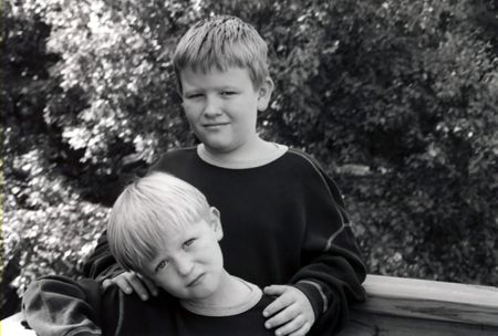 Black and white portrait of two serious boys. Stock Photo