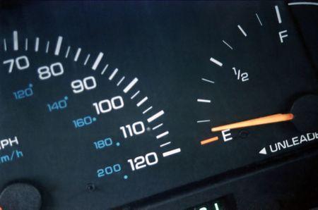 Closeup of car speed and gas gauges.