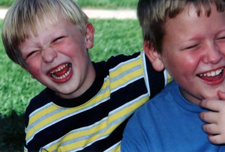 horseplay: Casual portrait of two brothers laughing.