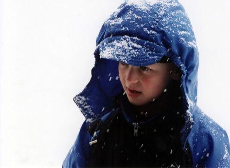 Portrait of boy in a snowstorm.