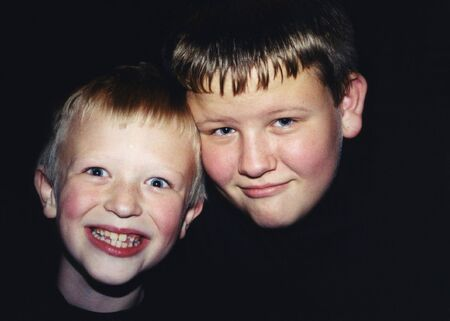 Portrait of two boys with different personalities.