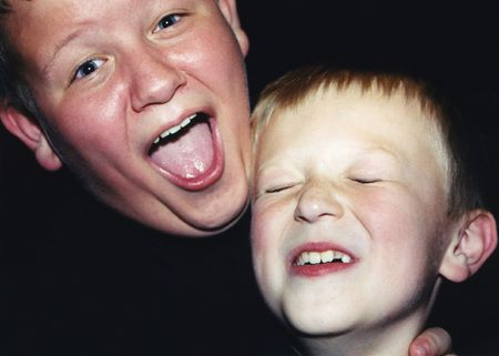 horseplay: Casual portrait of two brothers acting silly.