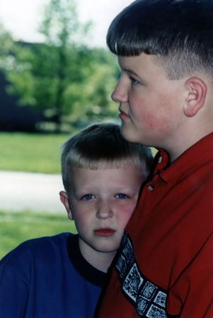 Portrait of two brothers, younger facing forward, older in profile. Stock Photo - 354447