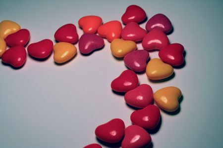 Group of heart candies in an uneven line. Stock fotó
