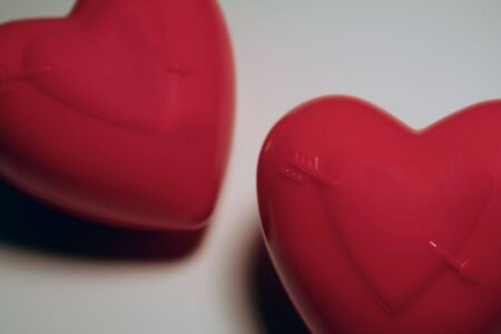 Closeup of two separate hearts, one slightly above the other. Reklamní fotografie