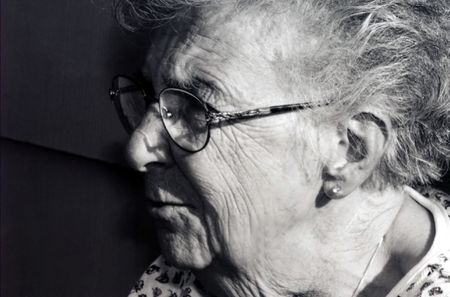 Black and white profile of senior citizen woman.