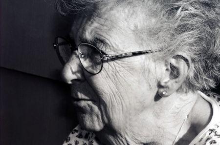 converse: Black and white profile of senior citizen woman.