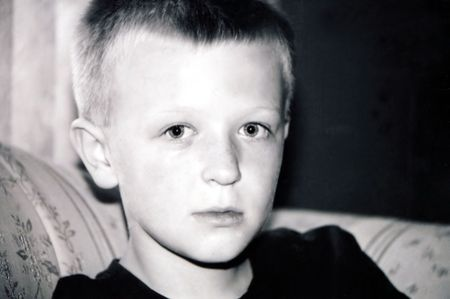 Black and white serious portrait of preteen boy.