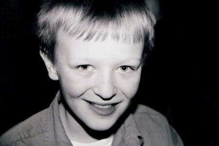Black and white smiling portrait of preteen boy. Stock Photo