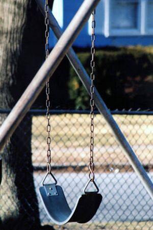 Empty swing in a playground.