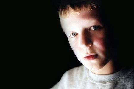 Portrait of boy with ghostly lighting.