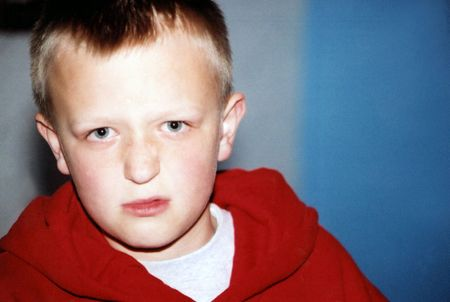 disapprove: Preteen boy with displeased expression.