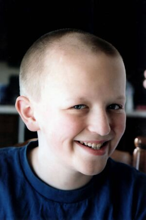 Portrait of preteen boy with new short haircut. Stock Photo