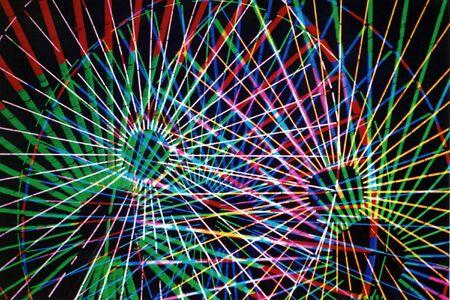 multiple exposure: Abstract esposizione multipla di un ruota Ferris.