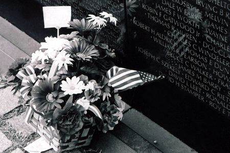 Flowers left at the base of the Vietnam Wall Memorial in Washington, D.C.