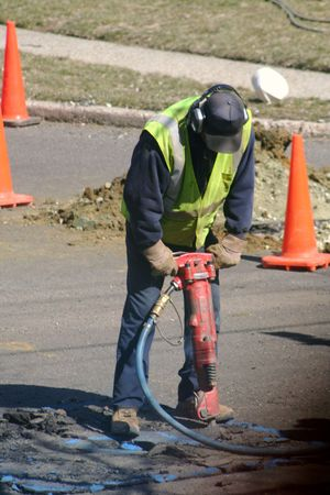 gouge: Worker using a jackhammer.