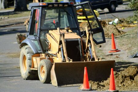 front end: Utility workers using a front end loader. Stock Photo