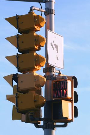 dont walk: Multiple traffic signals and signs.