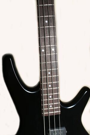 Black bass guitar on white background.