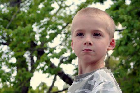 zealous: Stern faced boy.