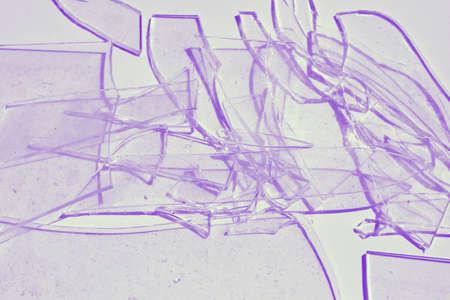 Broken glass tinted purple.