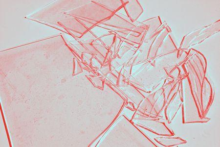 Broken glass tinted red. Фото со стока
