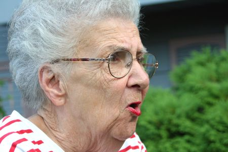 Angry senior citizen woman in 34 profile.
